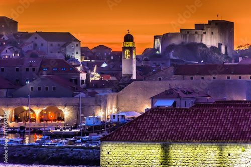 Poster Aubergine Dubrovnik city sunset. / Sunset over medieval town Dubrovnik, famous tourist travel destination on Adriatic Sea, Croatia Europe.