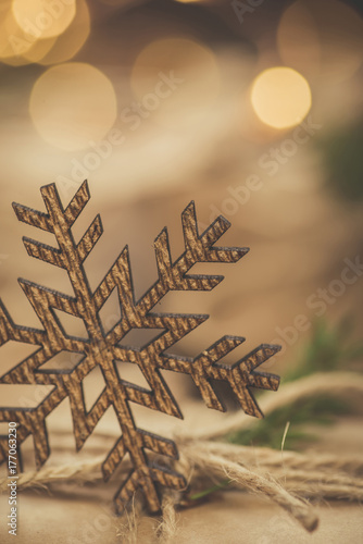 Christmas. Gifts. Vintage style snowflake with bokeh lights Poster