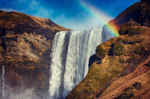 A rainbow reflecting at the top of Skogafoss Waterfall - 177068650