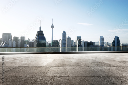 empty marble floor with modern buildings Poster