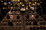 Control switches in airplane cockpit closeup with selective focus. - 177088434