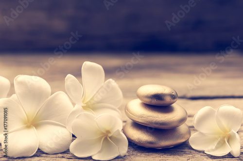 Pile of zen stones and Frangipani flower isolated on white background - 177091085