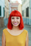 Attractive red hair girl in the street - 177098849