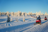 Group of snowmobiles in Lapland, near Saariselka, Finland - 177108892