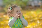 Happy little girl in  park - 177110624
