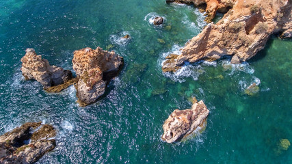Aerial. Rocks and beaches near beaches of Portimao.