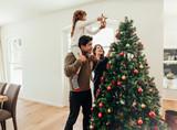 Family celebrating Christmas at home. - 177121279