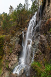 great cascading waterfall in a mountainous area