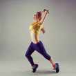 Female dancer training zumba over studio background.