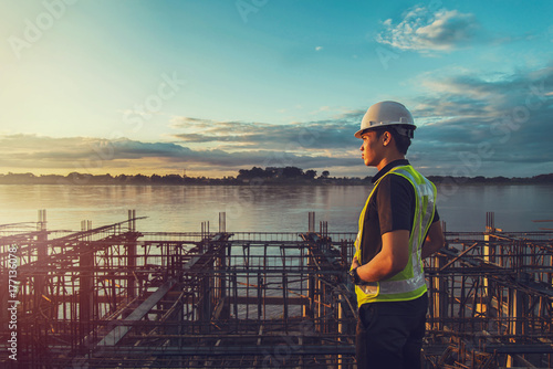 engineer working on building site. Poster
