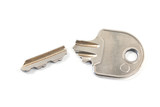 Broken house key isolated on white background