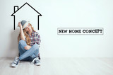 Dreaming concept. Young lady moving in new house - 177146406