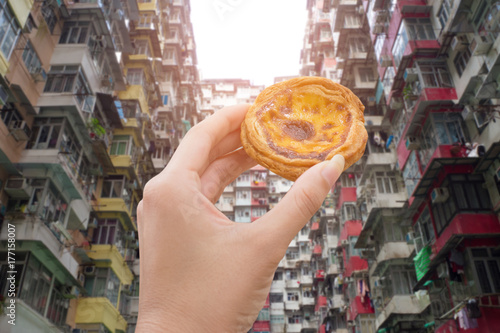 hand holding egg tart with old apartment in hongkong Canvas Print