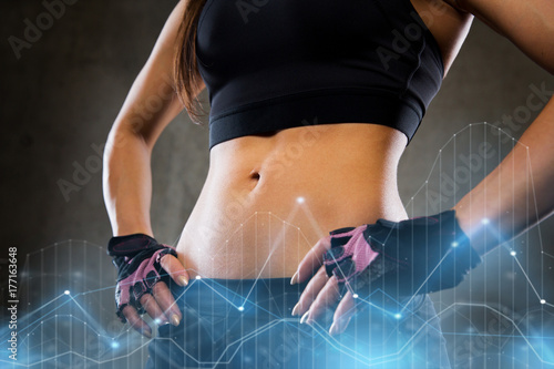 young woman body in gym Poster