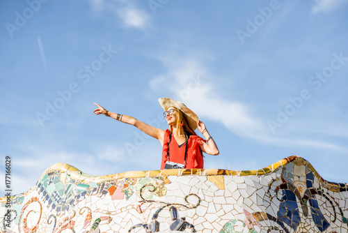 Keuken foto achterwand Barcelona View on the beautiful terrace decorated with mosaic with happy woman tourist in Guell park in Barcelona