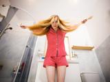 Woman brushing her long hair - 177175017