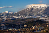 Morning winter view on the city of Gap and Ceuze mountain covered in fresh snow. Hautes-Alpes, Southern French Alps, France - 177181085