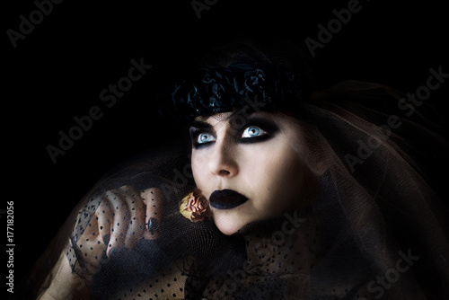 darkhair gothic girl with black lips and dry rose in her hand Poster