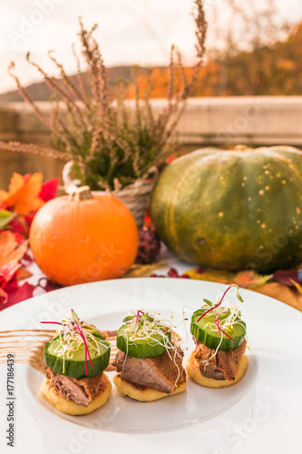 Autum delicious food photoshoot - fall composition with pumpkin, heather, leaves - 177186439
