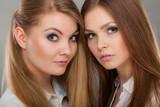 Two beautiful women, blonde and brunette posing - 177218202