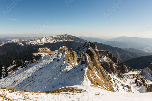 Aluminium Blauwe jeans Beautiful winter landscape. Winter forest and fields. Mountains in the clouds. winter landscape