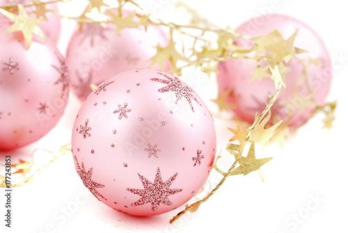 Christmas balls, pink on white background.