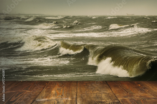 Table on stormy sea background