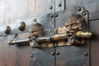 Lion head chinese door locker on a brown wooden door, China