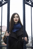 beautiful girl with long hair in a coat - 177258624