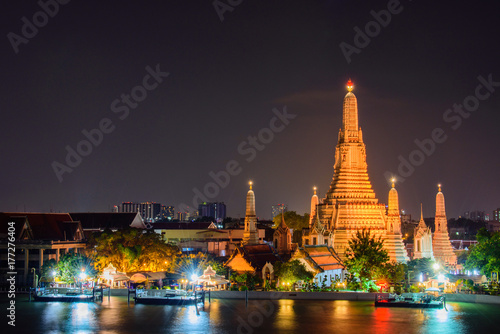 Arun temple (Wat Arun), famous tourist attraction in night time,Bangkok Thailand Poster
