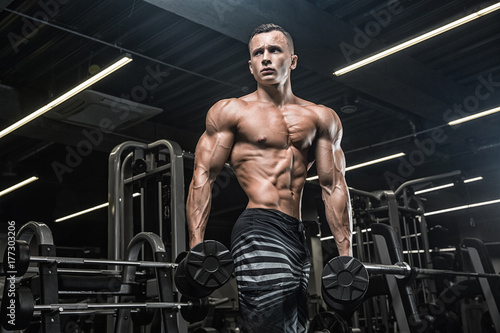 Brutal strong athletic men pumping up muscles workout bodybuilding concept backg Poster