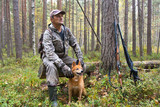 hunter with dogs finnish spitz during the rest - 177305004