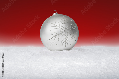 Fotobehang Rood paars Grey and Silver Christmas Bauble on fake white snow