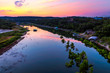The sun rises behind the Pedernales River in the Texas hill country