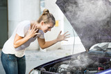 Frustrated Woman Looking At Broken Down Car Engine - 177346841
