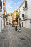 Typical street in old town of Ibiza, Balearic Islands, Spain. Morning light. Wide angle