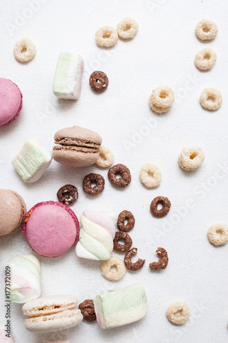 Colorful sweets on white background top view Poster