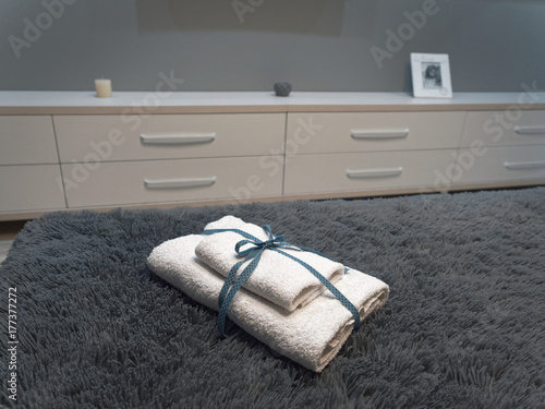 Bath towels rolled up by an envelope. Poster