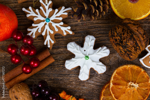 christmas gingerbread snowflake cookie with otanges, spices and decorations Poster
