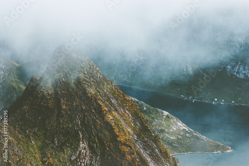 Fotobehang Groen blauw Foggy Mountains Landscape aerial view from Hermannsdalstinden summit in Norway scandinavian Travel hike Lofoten islands