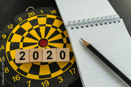 Poster Business target or goals concept with 2020 wooden block with pencil on white pap