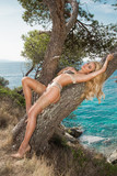 Beautiful sexy blonde woman in elegant lingerie on a background of beautiful sea view in Greece, Santorini - 177397876