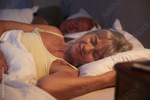 Peaceful Senior Woman Asleep In Bed At Night
