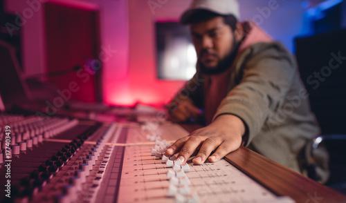 Fotobehang Muziek Sound engineer working on music mixer