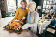 senior mother and daughter with thanksgiving turkey
