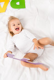happy baby with paper letter - 177423244