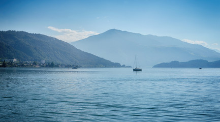 Swiss lake zug with boats and ferry and blue sky