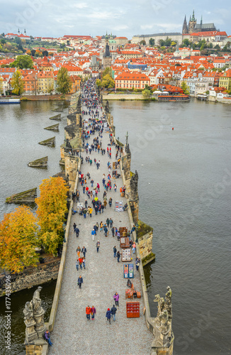 Prague, Czech Republic - October 12, 2017: Panorama of ancient Charles Bridge crosses the Vltava river in Prague, Czech Republic Poster