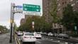 A daytime overcast establishing shot of traffic headed to the Brooklyn Bridge. Shot on the Brooklyn side of the bridge.