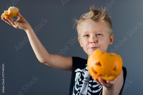 Boy in skeleton costume celebrating Halloween Poster